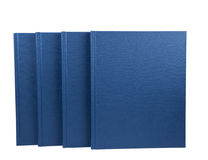 Four blue notepads isolated Stock Photography