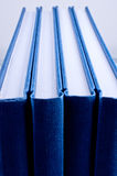 Four blue notepads isolated close up Royalty Free Stock Images
