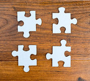 Four blue pieces of puzzle Stock Image