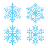 Four blue snowflakes Stock Photos