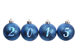 Four blue spangled christmas balls arranged in the year 2015 Stock Photo