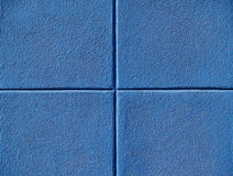 Four Blue Squares. On a concrete wall Stock Images