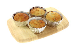 Four Blueberry Muffins Cutting Board Stock Image