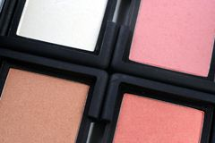Four blush compacts. Closeup of four colored blush makeup compacts Royalty Free Stock Images