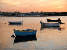 Four boats anchored. Four little boats anchored in calm waters at the end of the day Royalty Free Stock Image