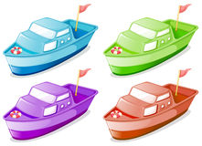 Four boats in different colors Stock Photos