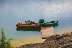 Four boats on the dock. Royalty Free Stock Photography