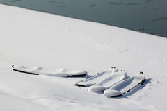 Four boats in snow Stock Image