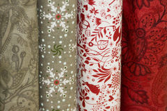Four bolts of fabric in a fabric store. Stock Photo
