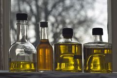 Four bottle of olive oil royalty free stock images