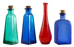 Four bottles. Four small color decorative bottles stock photography