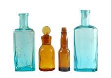 Four bottles. Four small color decorative bottles stock photos