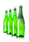 Four bottles of champagne in row. On white background royalty free stock photography