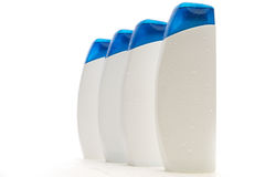 Four bottles with hygienic products. On a white stock images