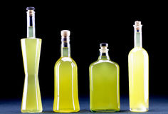 Four bottles in line of  Sorrento limoncello, dark background Stock Photography