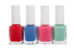 Four bottles of nail polish Stock Photos