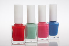 Four bottles of nail polish Royalty Free Stock Images