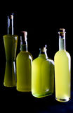Four bottles of sorrento limoncello , black backround Royalty Free Stock Photos