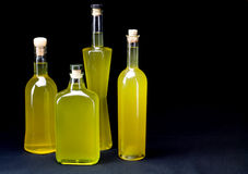 Four bottles of sorrento limoncello  horizontal, black backgroun Stock Image