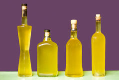 Four bottles of Sorrento limoncello on violet background Stock Photography