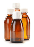 Four bottles of syrup medication on white Royalty Free Stock Photos