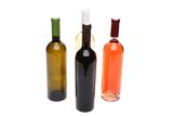Four bottles of wine. Four bottles of wine of different sorts on the white background Royalty Free Stock Photos