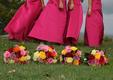 Four bouquets. With four bridesmaids behind Stock Photo