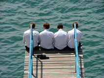 Four bouys. Four boys sat at the end of a diving board, on the devon coast Royalty Free Stock Photo