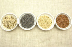 Four bowl with different seeds Stock Photo