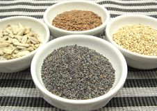 Four bowl with different seeds Royalty Free Stock Photos