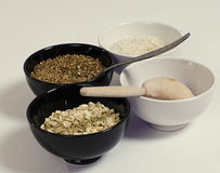 Four bowls with grain Stock Photography