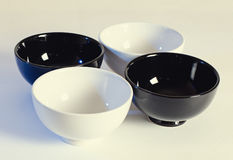 Four bowls on a light background Royalty Free Stock Photography
