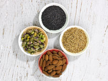 Four bowls of nuts and seeds Stock Photos