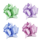 Four Bows. Four colored bows in green, lilac, blue and pinkcolor isolated on white background Royalty Free Stock Photography