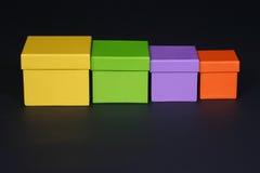 Four boxes. Vivid boxes on black royalty free stock photos