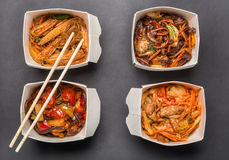Four boxes of Chinese food and chopsticks Royalty Free Stock Photo