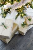 Four Boxes Near Lighted String Lights Stock Photo