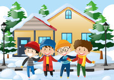 Four boys standing on the road covered with snow Royalty Free Stock Photography