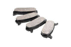 Four brake pads, isolatet on white Royalty Free Stock Photos