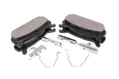 Four brake pads and spring Royalty Free Stock Images