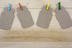 Four bright colorful clothespins on the rope with notes Stock Images