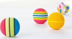 Four Bright Colourful Patterned Foam Balls. Stock Photos