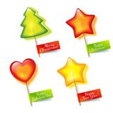Four bright holiday lollipop Stock Photos