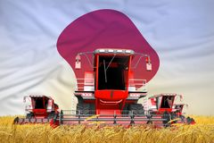 Industrial 3D illustration of four bright red combine harvesters on rural field with flag background, Japan agriculture concept. Four bright red combine stock illustration