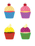 Four bright vivid tasty cupcakes Royalty Free Stock Photography