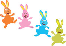 Four brightly colored Easter bunnies. A cartoon illustration of four brightly colored Easter bunnies jumping and hopping Stock Photos