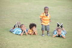 Four brothers. Four African American brothers enjoying the day at the park stock photography