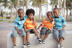 Four brothers in the park. Four adorable African American brothers enjoying the day in the park stock image