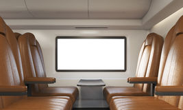 Four broun armchairs in sunlit train compartment Royalty Free Stock Image