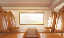 Four brown armchairs in sunlit train compartment Stock Image